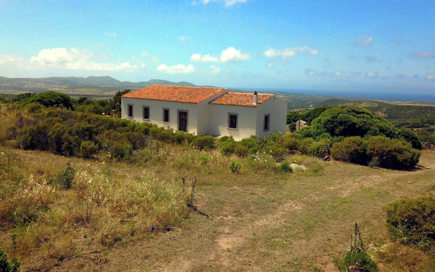 1.5  Ha Land With Sea-Vistas and 164 M2 Cottages for Sale in Aglientu, 5,5 Km from the Sea, Northern Sardinia